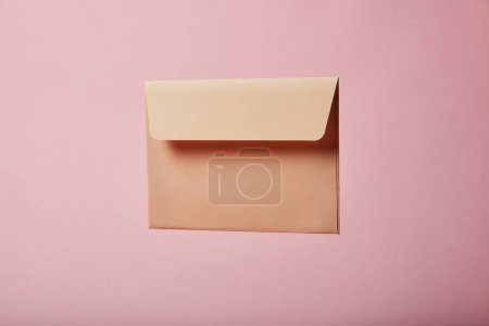 Photo for Beige and empty envelope on pink background with copy space - Royalty Free Image