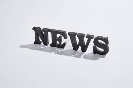 Photo pour Lettrage d'actualités avec ombres et espace de copie sur blanc - image libre de droit