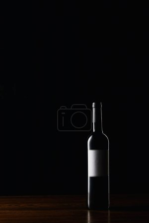 Photo for Wine bottle with blank label on wooden surface - Royalty Free Image