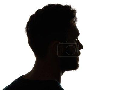 Photo pour Silhouette de l'homme pensive regardant loin isolé sur le blanc - image libre de droit