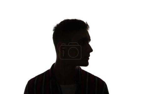 Photo pour Silhouette de l'homme en chemise rayée regardant loin isolé sur le blanc - image libre de droit