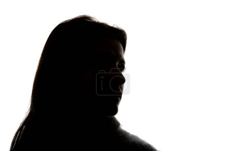 Silhouette of woman looking away isolated on white