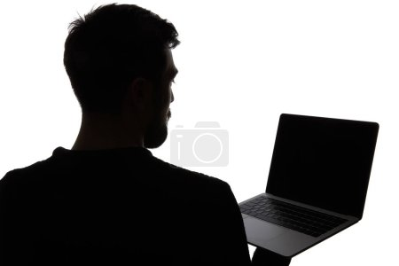Silhouette of man holding laptop with blank screen isolated on white