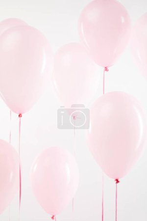Photo for Background with pink festive air balloons on white - Royalty Free Image