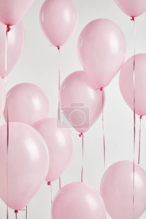 Photo for Background with decorative pink air balloons isolated on white - Royalty Free Image
