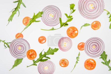 Photo for Background with sliced red tomatoes, red onions and green arugula leaves - Royalty Free Image