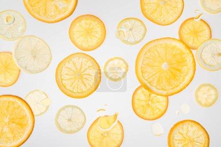 bright fresh orange and lemon slices on grey background