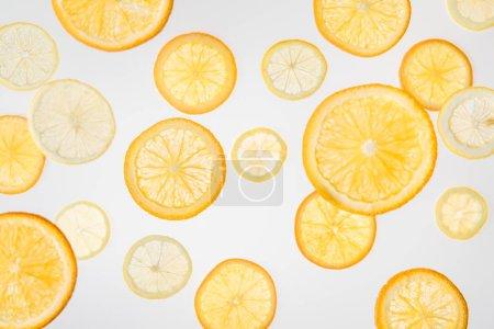 bright orange and lemon slices on grey background