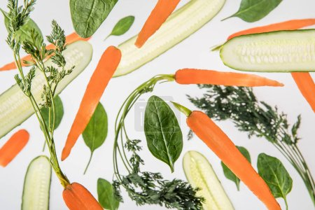 Photo for Background with carrots, sliced cucumbers, spinach leaves - Royalty Free Image
