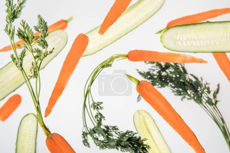 Photo for Background with sliced fresh carrots and cucumbers - Royalty Free Image