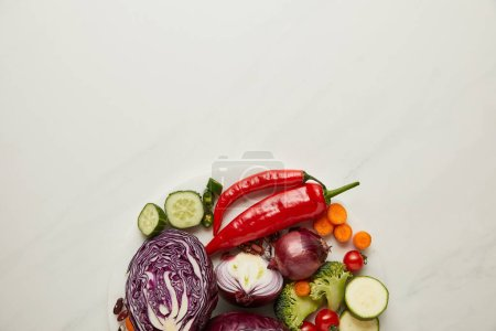 Photo for Top view of fresh cut and whole vegetables on white surface - Royalty Free Image