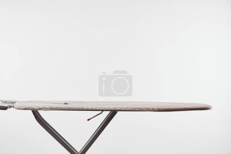 Photo for Ironing board with dark steel legs isolated on white - Royalty Free Image