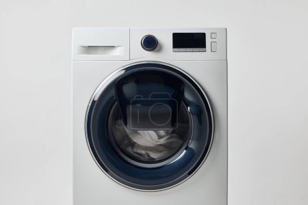 Photo for Modern washing machine with black display isolated on grey - Royalty Free Image