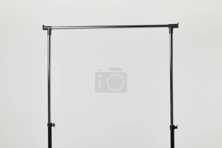 Photo for Black steel straight rack isolated on light grey - Royalty Free Image