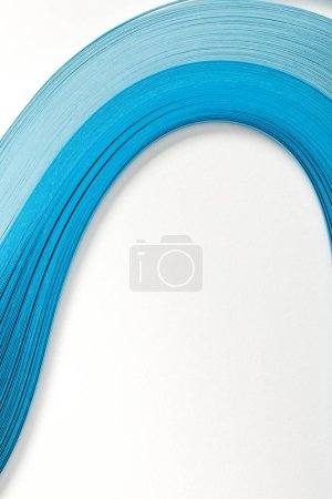 wavy blue abstract paper lines on white background