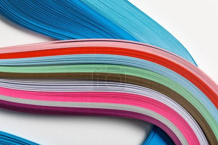 Photo for Close up of wavy multicolored rainbow paper lines on grey background - Royalty Free Image