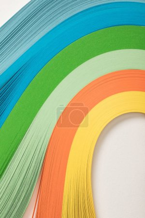 close up of wavy rainbow paper lines on grey background