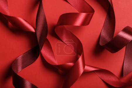 Photo for Close up of silk burgundy and red ribbons on red background - Royalty Free Image