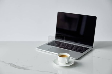 Photo for Laptop with blank screen and white coffee cup isolated on grey - Royalty Free Image