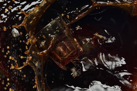 Photo for Overturned glass with black coffee, big splash and drops - Royalty Free Image