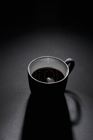 Photo for Cup of black coffee on dark textured surface - Royalty Free Image
