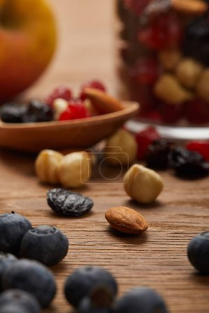 close up of blueberries and nuts on wooden table