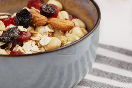Photo for Close up of bowl with muesli on striped napkin - Royalty Free Image