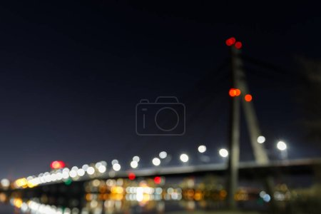 Photo for Bokeh lights and defocused buildings at dark night - Royalty Free Image
