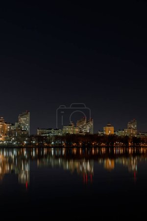 Photo for Illuminated buildings with reflection on water at night - Royalty Free Image
