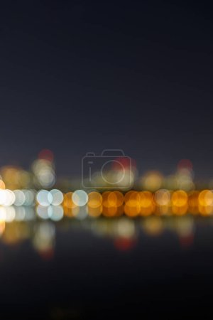 blurred bokeh lights of calm city at nigh