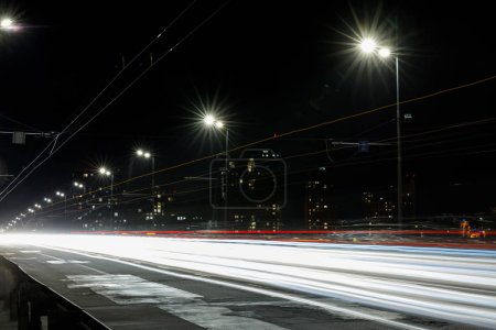 Photo for Long exposure of lights on road at night near buildings - Royalty Free Image
