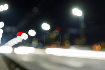 long exposure of bright lights on road at nighttime
