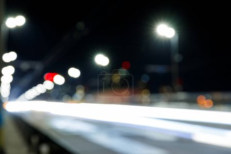 Photo for Long exposure of bright city lights on road at night - Royalty Free Image