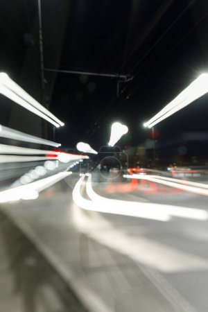 long exposure of bright lights on busy road at nighttime in city