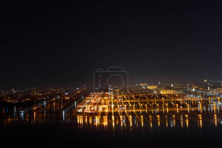 Photo for Aerial view of tranquil cityscape with illuminated buildings at night - Royalty Free Image