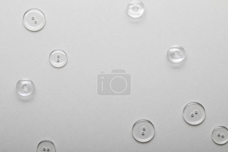 Photo for Top view of transparent clothing buttons isolated on grey with copy space - Royalty Free Image