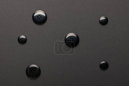 Photo for Top view of clothing buttons isolated on black - Royalty Free Image