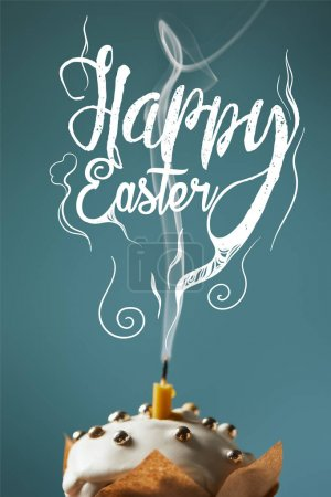 selective focus of traditional Easter cake with fireless candle and smoke on blue background with happy easter lettering