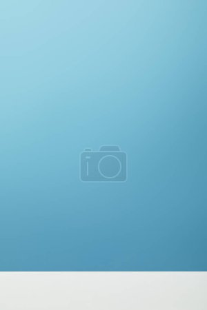 Foto de White surface on blue empty background with copy space - Imagen libre de derechos