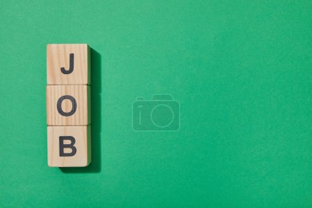Photo for Top view of wooden blocks with letters on green surface - Royalty Free Image
