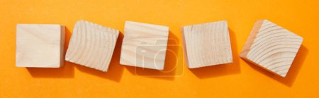 Photo for Panoramic shot of wooden blocks on orange surface - Royalty Free Image