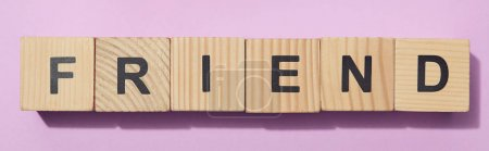 Photo for Panoramic shot of wooden cubes with letters on purple surface - Royalty Free Image
