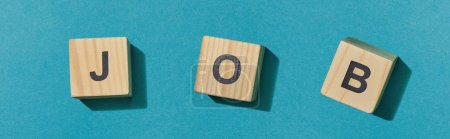 Photo for Panoramic shot of wooden cubes with letters on blue surface - Royalty Free Image