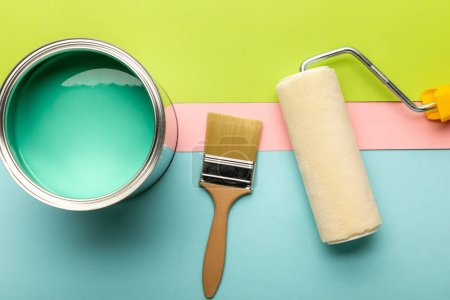 Photo for Top view of tin with green paint, paint roller and brush - Royalty Free Image