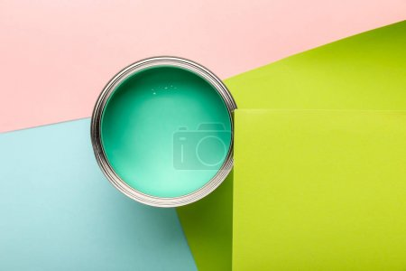 Photo for Top view of tin with green paint on colorful surface - Royalty Free Image