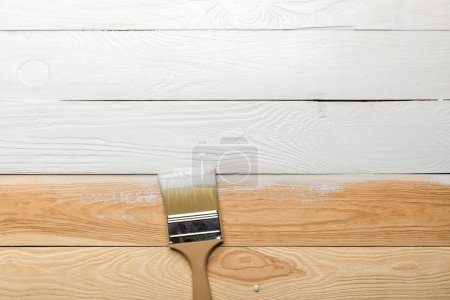 Photo for Top view of brush on white wooden surface - Royalty Free Image