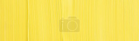 Photo for Panoramic shot of textured yellow surface with copy space - Royalty Free Image
