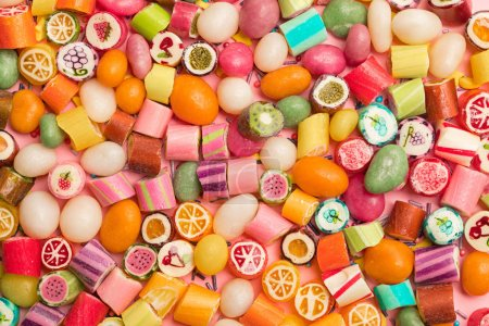 Photo for Top view of bright delicious multicolored caramel candies - Royalty Free Image