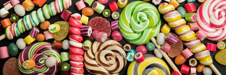 Photo for Panoramic shot of bright round and swirl lollipops among fruit caramel candies - Royalty Free Image