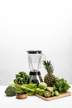 Photo for Blender near fresh, green vegetables and tasty fruits on white - Royalty Free Image